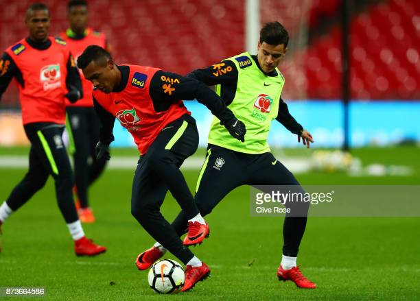 Alex Sandro of Brazil and Philippe Coutinho of Brazil during a Brazil training session ahead of the International Friendly Match between England and...