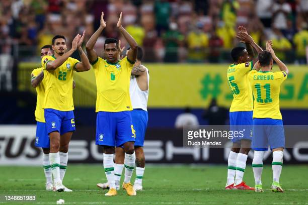 Alex Sandro of Brazil and teammates acknowledge the fans after winning a match between Brazil and Uruguay as part of South American Qualifiers for...