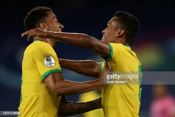 Alex Sandro of Brazil celebrates with teammate Danilo da Silva of Brazil after scoring the first goal of his team during a match between Brazil and...
