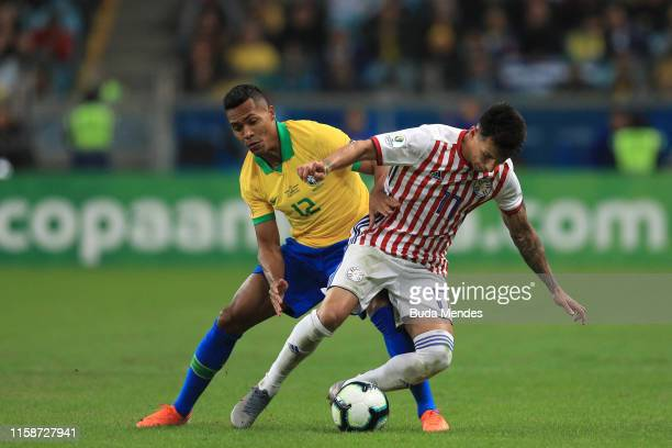 Alex Sandro of Brazil fights for the ball with Hernan Perez of Paraguay during the Copa America Brazil 2019 quarterfinal match between Brazil and...