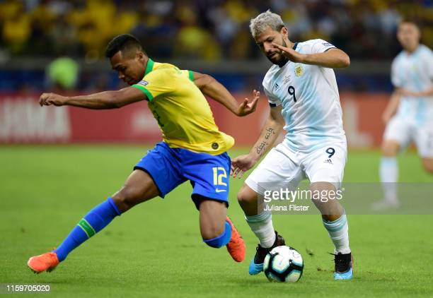 Alex Sandro of Brazil fights for the ball with Sergio Aguero of Argentina during the Copa America Brazil 2019 Semi Final match between Brazil and...