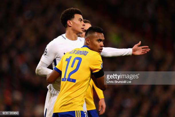 Alex Sandro of Juventus and Dele Alli of Tottenham Hotspur tussle for position during the UEFA Champions League Round of 16 Second Leg match between...
