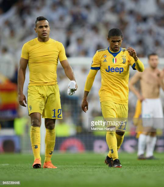 Alex Sandro of Juventus and Douglas Costa of Juventus show their disappointment after the UEFA Champions League Quarter Final Second Leg match...