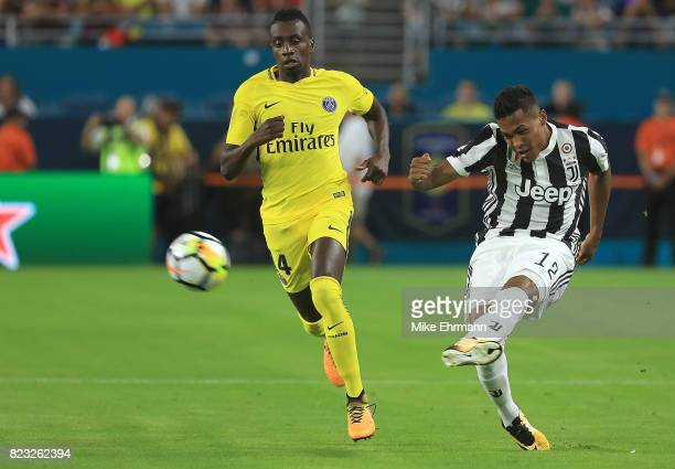 Alex Sandro of Juventus and Grzegorz Krychowiak of Paris SaintGermain fight for the ball during the International Champions Cup 2017 match at Hard...