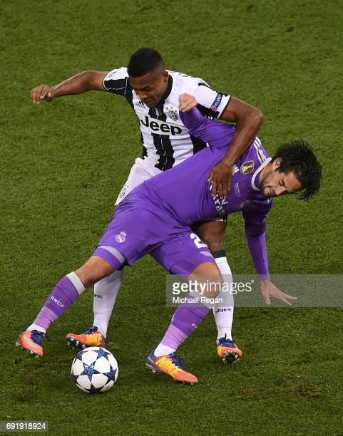 Alex Sandro of Juventus and Isco of Real Madrid battle for possession during the UEFA Champions League Final between Juventus and Real Madrid at...