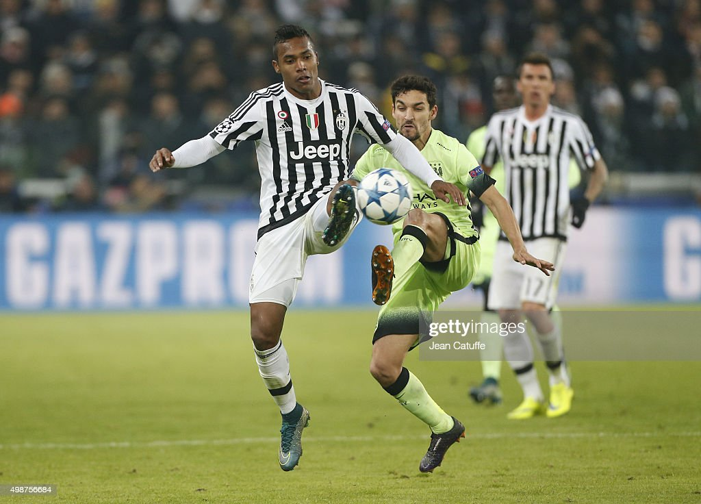 Alex Sandro of Juventus and Jesus Navas of Manchester City in action during the UEFA Champions League match between Juventus Turin and Manchester City FC at Juventus Stadium on November 25, 2015 in Turin, Italy.