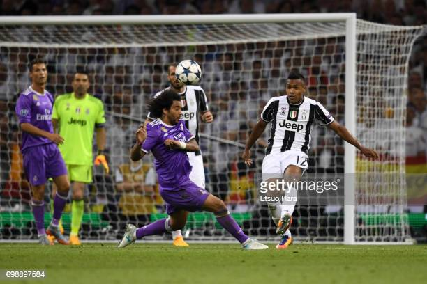 Alex Sandro of Juventus and Marcelo of Real Madrid compete for the ball during the UEFA Champions League final match between Juventus and Real Madrid...