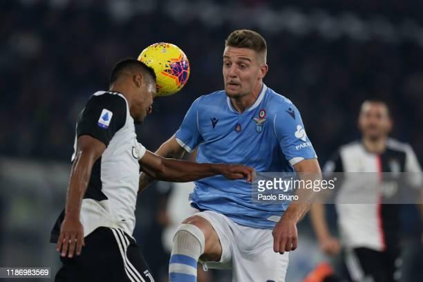 Alex Sandro of Juventus and Sergej Milinkovc Savic of SS Lazio in action during the Serie A match between SS Lazio and Juventus at Stadio Olimpico on...