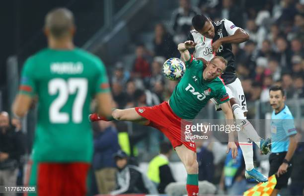 Alex Sandro of Juventus and Vladislav Ignatyev of Lokomotiv Moskva during the UEFA Champions League Group stage match FC Juventusv v FC Lokomotiv...
