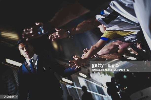Alex Sandro of Juventus arrives at the stadium and greets fans before the Serie A match between Juventus and SSC Napoli at Allianz Stadium on...