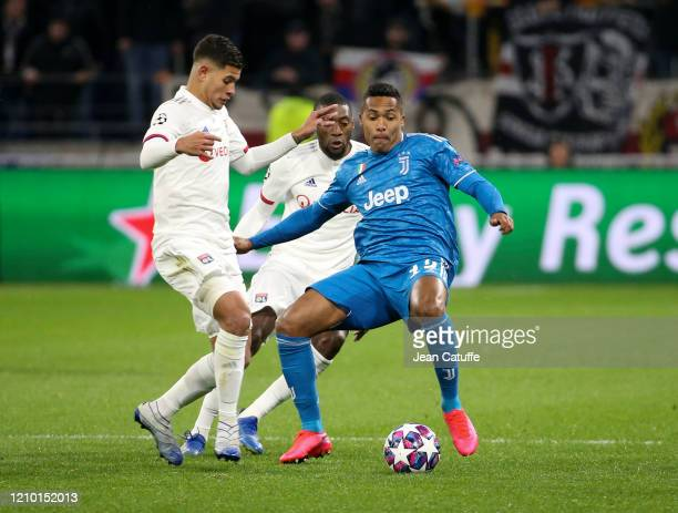 Alex Sandro of Juventus Bruno Guimaraes of Lyon during the UEFA Champions League round of 16 first leg match between Olympique Lyonnais and Juventus...