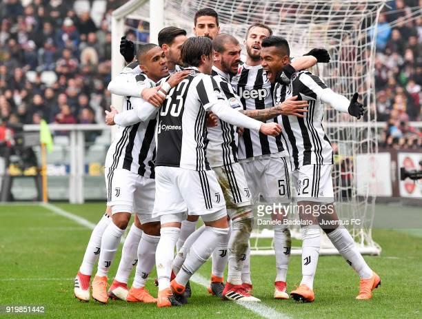 Alex Sandro of Juventus celebates scoring the opening goal goal during the serie A match between Torino FC and Juventus at Stadio Olimpico di Torino...