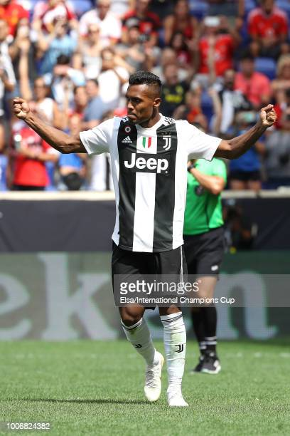 Alex Sandro of Juventus celebrates after scoring the last penalty kick in overtime during the International Champions Cup at Red Bull Arena on July...