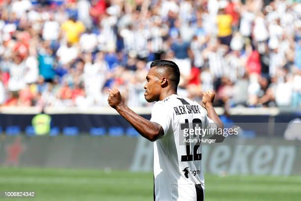 Alex Sandro of Juventus celebrates his game winning goal in penalty kicks against Benfica during the International Champions Cup 2018 match between...