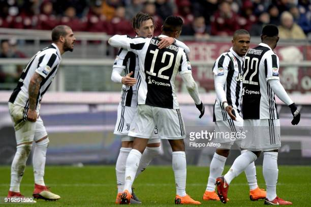 Alex Sandro of Juventus celebrates with Federico Bernardeschi after scoring a goal during the serie A match between Torino FC and Juventus at Stadio...