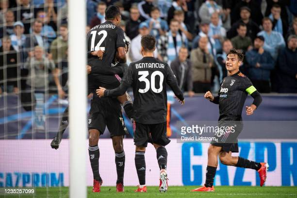 Alex Sandro of Juventus celebrates with teammates after scoring the 0-1 goal during the UEFA Champions League group H match between Malmo FF and...