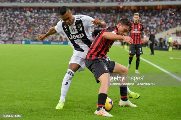 Alex Sandro of Juventus competes for the ball with Davide Calabria of AC Milan during the Italian Supercup match between Juventus and AC Milan at...