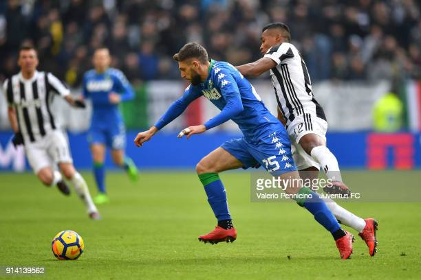 Alex Sandro of Juventus competes for the ball with Domenico Berardi of Sassuolo during the serie A match between Juventus and US Sassuolo on February...