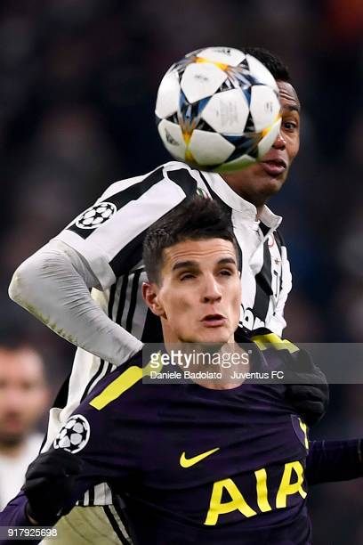 Alex Sandro of Juventus competes for the ball with Erik Lamela of Tottenham Hotspur FC during the UEFA Champions League Round of 16 First Leg match...