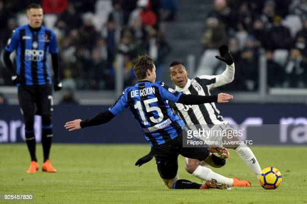 Alex Sandro of Juventus competes for the ball with Marten De Roon of Atalanta BC during the TIM Cup match between Juventus and Atalanta BC at Allianz...