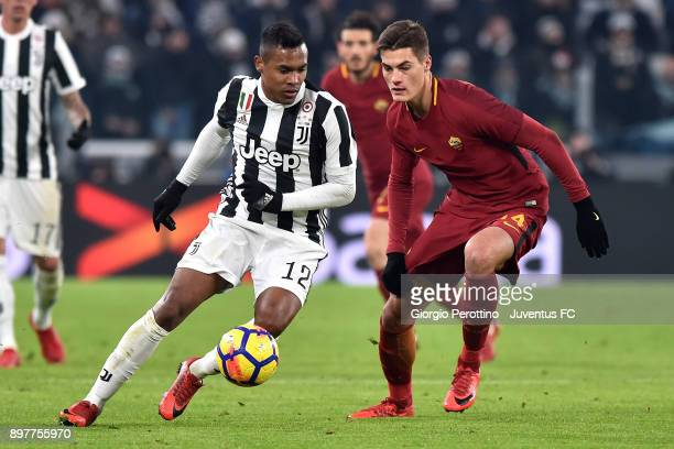 Alex Sandro of Juventus competes for the ball with Patrick Schick of AS Roma during the serie A match between Juventus and AS Roma at Allianz Stadium...