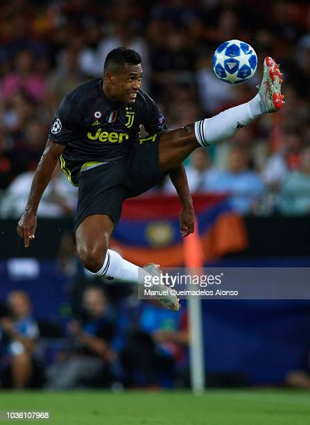 Alex Sandro of Juventus controls the ball during the Group H match of the UEFA Champions League between Valencia and Juventus at Estadio Mestalla on...