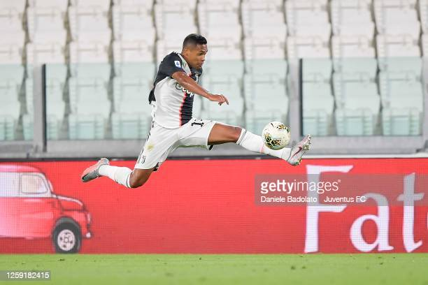 Alex Sandro of Juventus controls the ball during the Serie A match between Juventus and UC Sampdoria at Allianz Stadium on July 26, 2020 in Turin,...