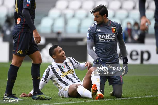 Alex Sandro of Juventus FC and Mattia Perin of Genoa CFC reacts during the Serie A match between Juventus and Genoa CFC at Allianz Stadium on April...