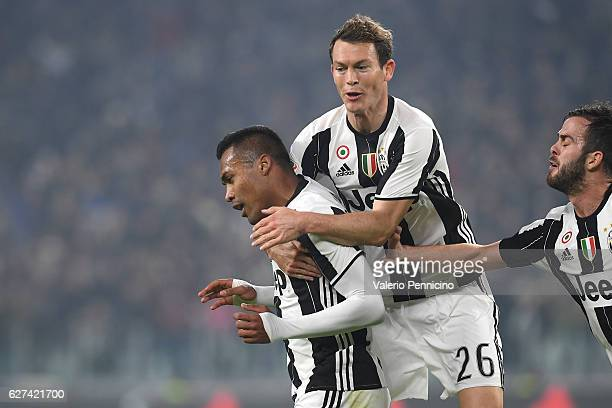 Alex Sandro of Juventus FC celebrates after scoring the opening goal with team mate Stephan Lichtsteiner during the Serie A match between Juventus FC...
