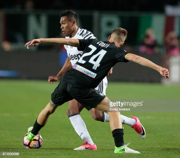 Alex Sandro of Juventus FC competes for the ball with Andrea Conti of Atalanta BC during the Serie A match between Atalanta BC and Juventus FC at...