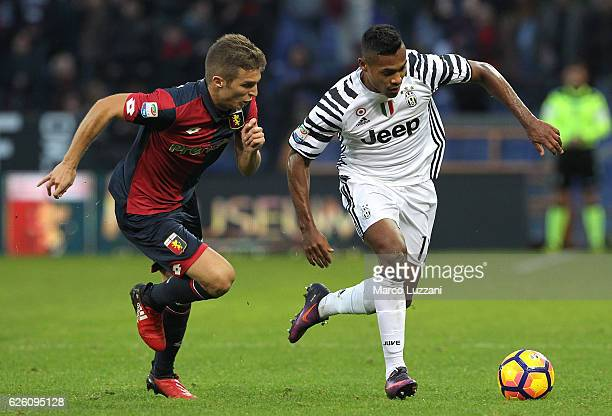 Alex Sandro of Juventus FC is challenged by Darko Lazovic of Genoa CFC during the Serie A match between Genoa CFC and Juventus FC at Stadio Luigi...