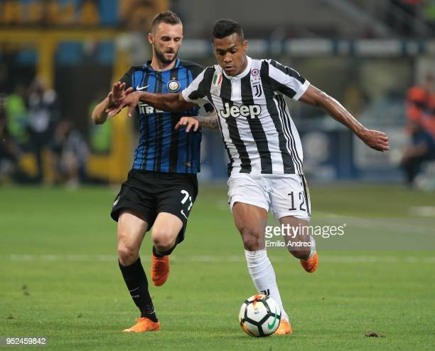 Alex Sandro of Juventus FC is challenged by Marcelo Brozovic of FC Internazionale Milano during the serie A match between FC Internazionale and...