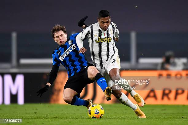 Alex Sandro of Juventus FC is tackled by Nicolo Barella of FC Internazionale during the Coppa Italia football match between Juventus FC and FC...