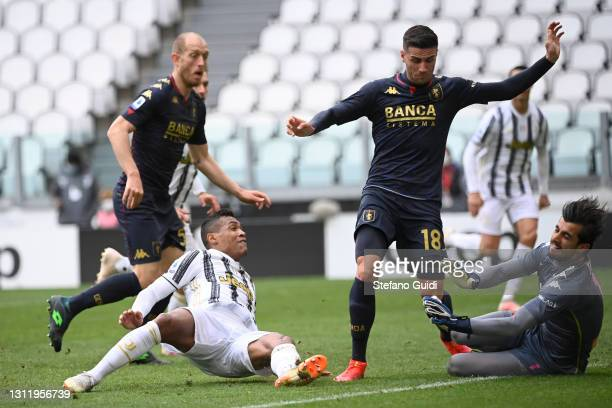 Alex Sandro of Juventus FC kicks the ball during the Serie A match between Juventus and Genoa CFC at Allianz Stadium on April 11, 2021 in Turin,...