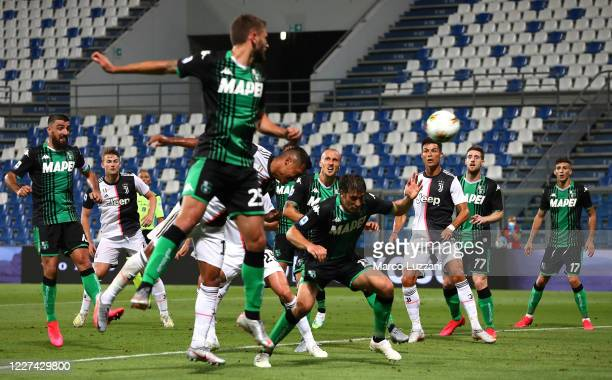Alex Sandro of Juventus FC scores his goal during the Serie A match between US Sassuolo and Juventus at Mapei Stadium Citta del Tricolore on July 15...