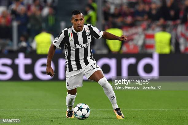 Alex Sandro of Juventus in action during the UEFA Champions League group D match between Juventus and Olympiakos Piraeus at Allianz Stadium on...