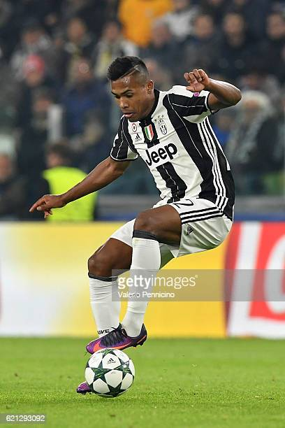 Alex Sandro of Juventus in action during the UEFA Champions League Group H match between Juventus and Olympique Lyonnais at Juventus Stadium on...