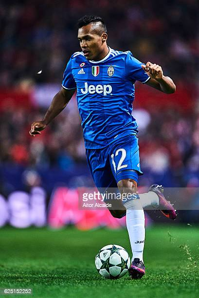 Alex Sandro of Juventus in action during the UEFA Champions League match between Sevilla FC and Juventus at Estadio Ramon Sanchez Pizjuan on November...