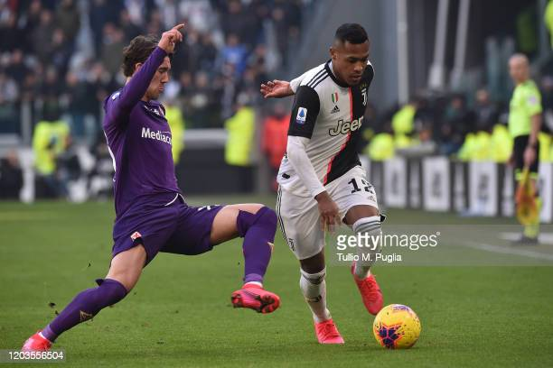 Alex Sandro of Juventus is challenged by Dusan Vlahovic of Fiorentina during the Serie A match between Juventus and ACF Fiorentina at Allianz Stadium...