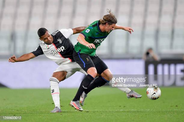 Alex Sandro of Juventus is challenged by Hans Hateboer of Atalanta BC during the Serie A match between Juventus and Atalanta BC at Allianz Stadium on...