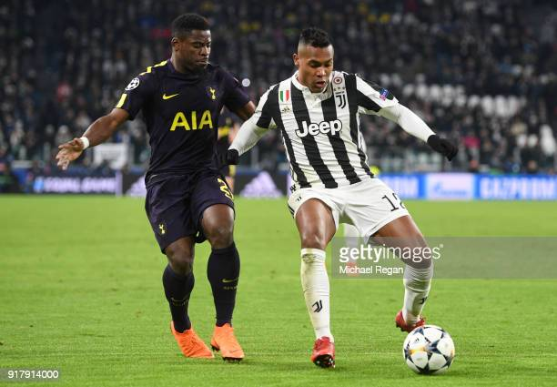 Alex Sandro of Juventus is challenged by Serge Aurier of Tottenham Hotspur during the UEFA Champions League Round of 16 First Leg match between...