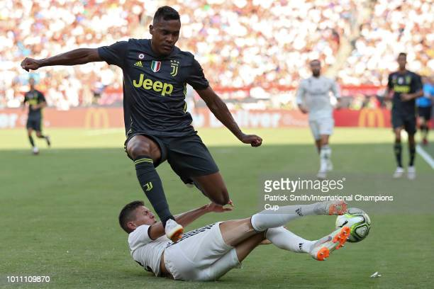 Alex Sandro of Juventus is tackled by Javier Sanchez of Real Madrid during the International Champions Cup at FedExField on August 4 2018 in Landover...