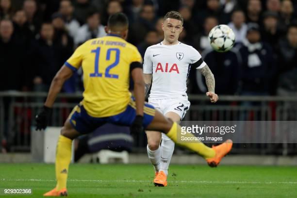 Alex Sandro of Juventus Kieran Trippier of Tottenham Hotspur during the UEFA Champions League match between Tottenham Hotspur v Juventus at the...