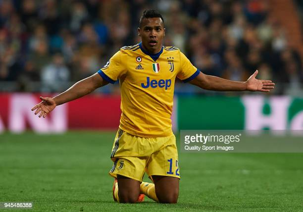 Alex Sandro of Juventus reacts on the pitch during the UEFA Champions League Quarter Final Second Leg match between Real Madrid and Juventus at...