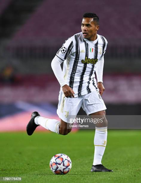 Alex Sandro of Juventus runs with the ball during the UEFA Champions League Group G stage match between FC Barcelona and Juventus at Camp Nou on...