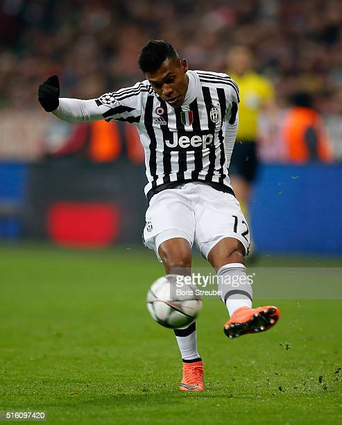 Alex Sandro of Juventus Turin runs with the ball during the UEFA Champions League round of 16 second leg match between FC Bayern Muenchen and...