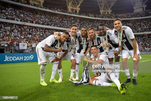 Alex Sandro Paulo Dybala Douglas Costa Miralem Pjanic Blaise Matuidi Rodrigo Bentancur and Cristiano Ronaldo of Juventus celebrate with trophy after...