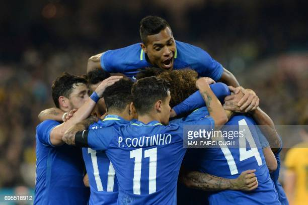 Alex Sandro Silva of Brazil celebrates a goal with teammates during the friendly international football match between Brazil and Australia in...
