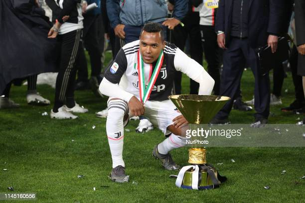 Alex Sandro with the trophy of Scudetto during the victory ceremony following the Italian Serie A last football match of the season Juventus versus...