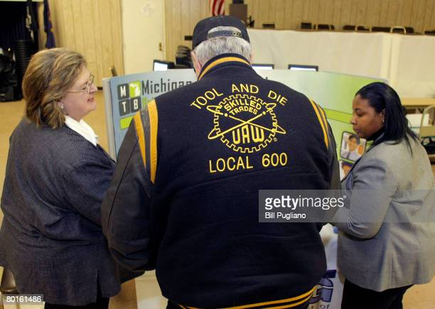 Alex Sands of Dearborn Heights, Michigan, a 43-year Ford Motor Company employee, attends a jobs fair at United Auto Workers Union Local 600 March 7,...